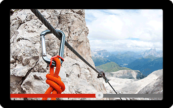 Screen showing a video of climbing with rope and carabiner