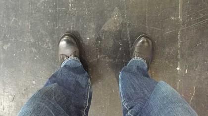 view down to feet on concrete floor