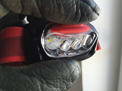 Pressing T-Line headlamp button with glove