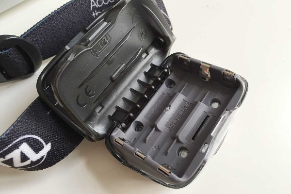 open battery compartment of Petzl Tikka headlamp