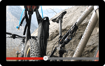 Screen showing a video of a mountain bike tour