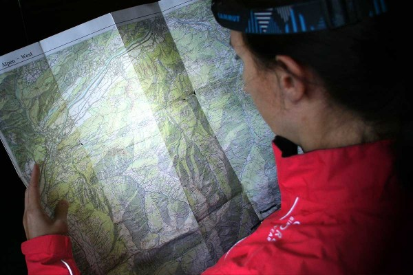 Alpine map illuminated by headlamp